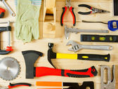 Many working tools on a wooden background. — Zdjęcie stockowe