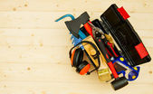 Tools in box on wooden background. — Stock Photo