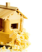 House construction. Joiners works. The wooden house, chisel, plane and shaving on white background. — Stok fotoğraf