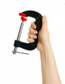 Clamp in hand on white background. — Stock Photo
