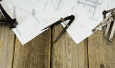 Many drawings for building and working tools on old wooden background. — Stock Photo