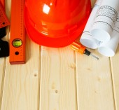 Repair work. Drawings for building, helmet, ruler and others tools on wooden background. — Stock Photo