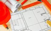 Repair work. Drawings for building, helmet, pencils on wooden background. — Stock Photo