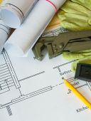 House construction. Drawings for building, wrench, gloves and others tools on wooden background. — ストック写真