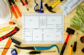 House construction. Drawings for building and many others tools on wooden background. — Stock Photo
