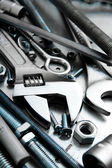 Wrench and tools on the scratched metal background. — Stock Photo
