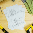 Repair work.. Drawings for building and working tools on wooden background. — Stock Photo #69177711
