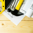 Drawings for building and working tools on wooden background. — Stock Photo #69177753