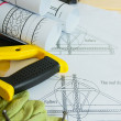 Repair work.. Drawings for building and working tools on wooden background. — Stock Photo #69177775