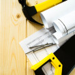 Drawings for building and working tools on wooden background. — Stock Photo #69177783