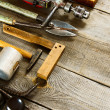 Many working tools on a wooden background. — Stock Photo #69178303
