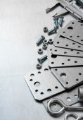 Calliper, blank and screws on the scratched metal background. — Stock Photo
