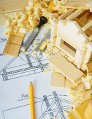Joiners works. Drawings for building, small house and working tools on wooden background. — Stockfoto