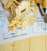 Joiners works. Drawings for building, small house and working tools on wooden background. — Foto Stock