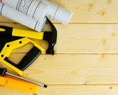 Drawings for building,saw, hammer and others tools on wooden background. — Stockfoto