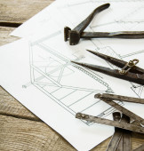 Many drawings for building and working tools on old wooden background. — Zdjęcie stockowe