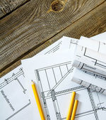 Many drawings for building and pencils on old wooden background. — Stock Photo