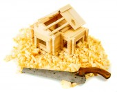 House construction. Joiners works. The small wooden house, saw and shaving on white background. — Stock Photo