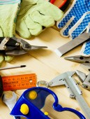 Many working tools on a wooden background. — Stock Photo