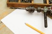 Paper with pencil and the vintage working tools on wooden background. — Stock fotografie