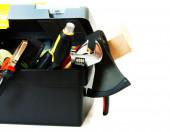 Muchas herramientas de trabajo en el cuadro sobre fondo blanco. — Foto de Stock