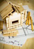 Many drawings for building, pencils and small house on wooden background. — 图库照片
