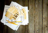 Many drawings for building and house on old wooden background. — Stock Photo