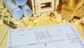 Woodworking. Drawings for building, small house and working tools on wooden background. — Stock Photo