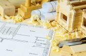 Woodworking. Drawings for building, small house and working tools on wooden background. — 图库照片