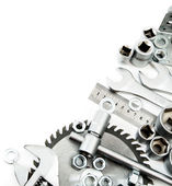 Metalwork. Spanner, ingot and others tools on white background. — Stock Photo