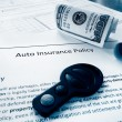 Cash and insurance policy — Stock Photo #72164465