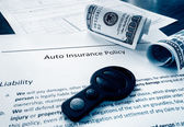 Cash and insurance policy — Stock Photo