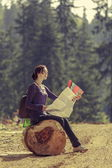Woman reading travel map — Stock Photo