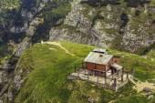 Desolate abandoned wooden mountain refuge — Stock Photo