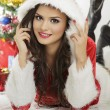 Smiling lady in Santa Claus outfit — Stock Photo #55655085