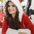 Smiling lady in Santa Claus outfit — Stock Photo #55655089