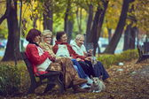 Retired women on a bench — Stock Photo