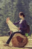 Young woman reading travel map — Stock Photo
