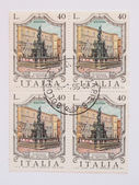 Mail stamp from Italy with the Neptune fountain in Bologna — Stock Photo