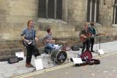 Rock band busking on main street — Stock Photo