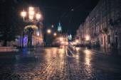 Vintage style image of old European city at night — Stock Photo