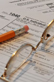 Tax form with eyeglasses and pencil — Stock Photo