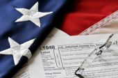 Tax form on american flag — Stock Photo