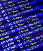 Arrival Times At An Airline Counter — Stock Photo