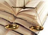 Scales Of Justice and books — Stock Photo