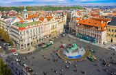 PRAGUE,CZECH REPUBLIC - OCTOBER 10: Old Town Square with tourists on October 10, 2013in Prague. Old Town Square is a historic square in the Old Town quarter of Prague in the Czech Republic — Stock Photo