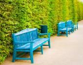 Blue wooden benches in park at Wallenstein Garden, Prague,Czech Republic — Stock Photo