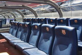BARCELONA, SPAIN - JUNE 12, 2011: Blue reserve players seats with symbols on Camp Nou Stadium in Barcelona. Camp Nou is the home arena for FC Barcelona and seats 99786 people — Stockfoto
