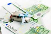 Toy car and euro — Stock Photo