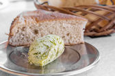 Herb-flavoured butter with bread — Stockfoto